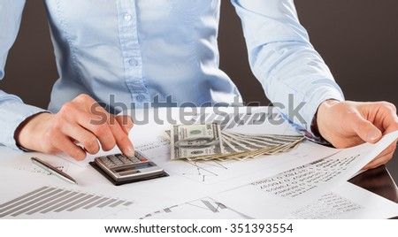Business accountant working with documents and money - stock photo