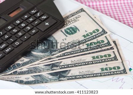 Business accounting concept. calculator and US 