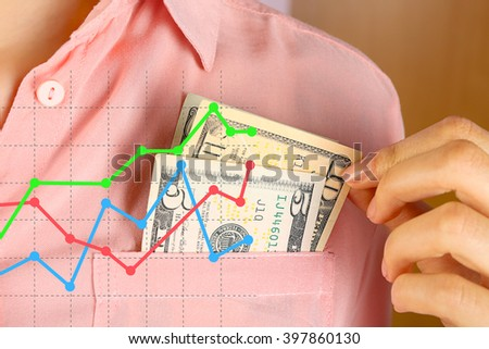 Business accounting concept. Money in pink shirt pocket, close up - stock photo