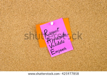 Business Acronym RAVE as Respect, Appreciate, Validate, Empowerwritten on paper note pinned on cork board with white thumbtack, copy space available - stock photo