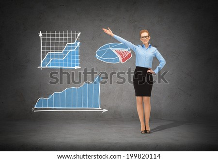 business, advertising and office concept - smiling businesswoman in eyeglasses pointing her hand - stock photo
