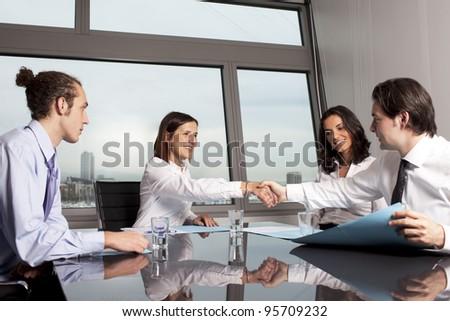 Business agreement among businesspeople - stock photo