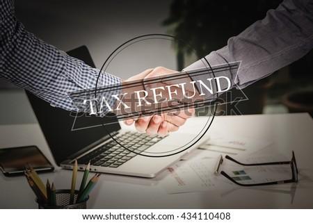 BUSINESS AGREEMENT PARTNERSHIP Tax Refund COMMUNICATION CONCEPT - stock photo