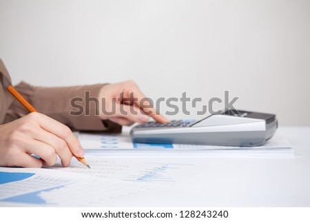 Business analysis - calculator, sheet, graph, (business report) and analyst woman. Selective focused on pencil. - stock photo