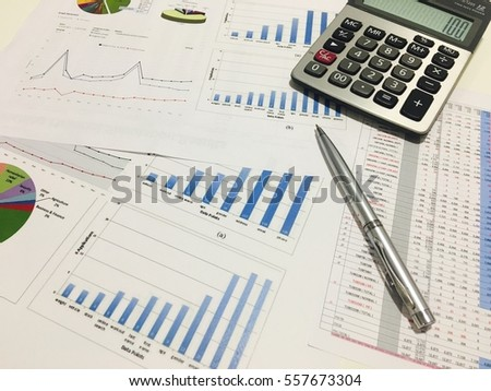 business analysis documents on office table with calculator and graph financial with social network diagram, vintage tone