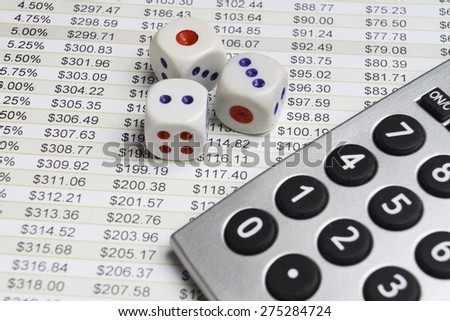 Business analysis with dice and calculator - stock photo
