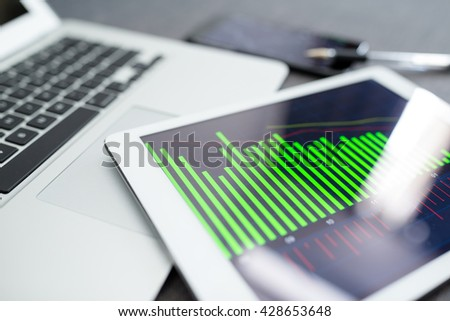 Business analytics on tablet computer - stock photo