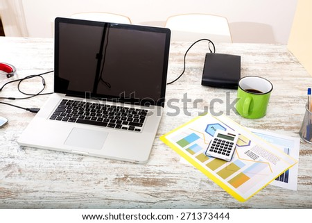 Business analytics with a Data sheet and a Laptop.  - stock photo