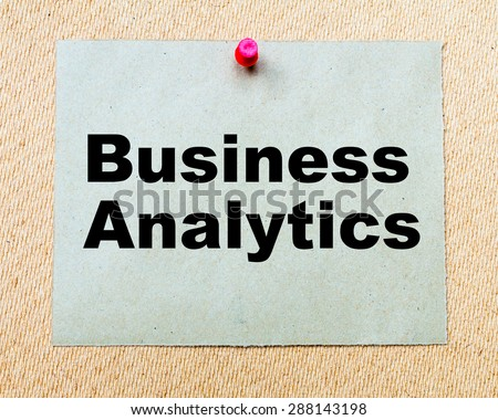 Business Analytics written on paper note pinned with red thumbtack on wooden board. Business conceptual Image - stock photo