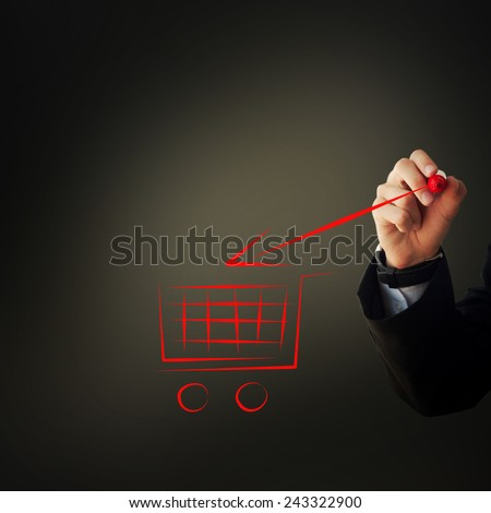 Business and advertisement concept. Close up of businessman drawing a shopping cart - stock photo