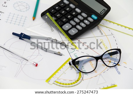 Business and  Architectural project, pair of compasses, glasses, rulers and calculator - business concept