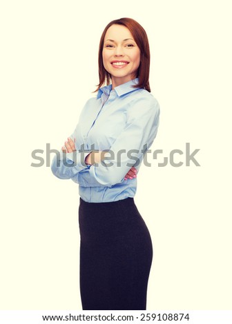 business and education concept - friendly young smiling businesswoman with crossed arms - stock photo