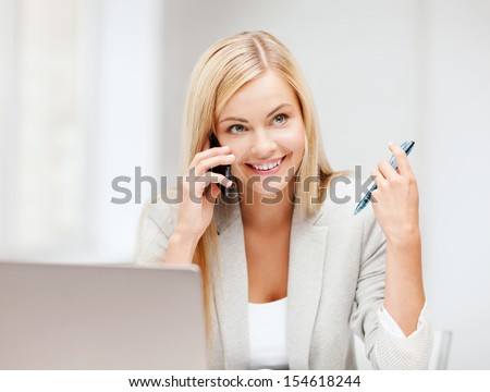 business and education concept - picture of businesswoman with laptop and cell phone - stock photo