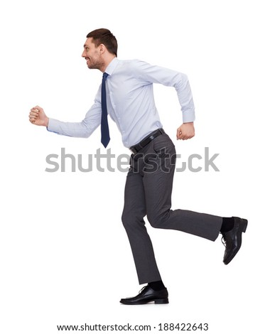 business and education concept - smiling businessman running