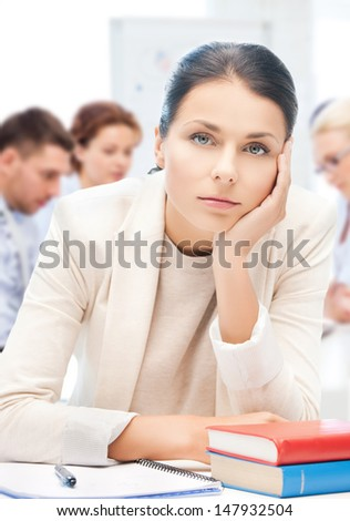 business and education concept - stressed businesswoman in office - stock photo