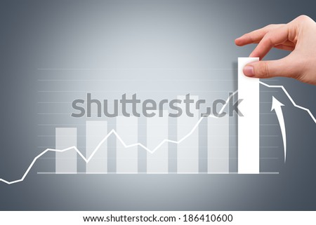 Business and finance concept, young male hand pulling bar of graph chart on digital screen. - stock photo