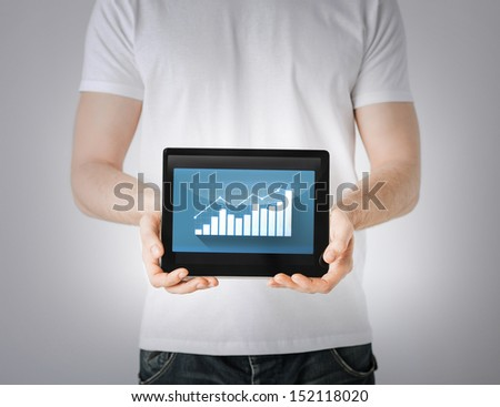 business and finance - man hands holding tablet pc with graph - stock photo