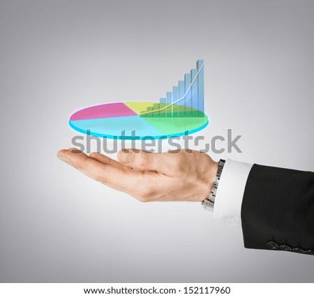 business and finances - businessman hand showing raising virtual chart - stock photo