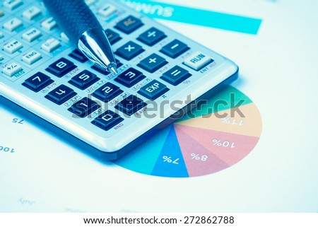 business and financial report with pen and calculator on wooden table.Document is mockup - stock photo