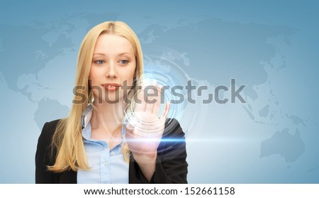 business and future technology - attractive businesswoman touching virtual screen - stock photo