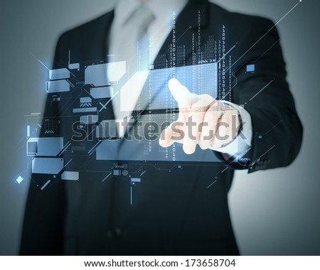 business and future technology concept - man hand pointing at virtual screen - stock photo