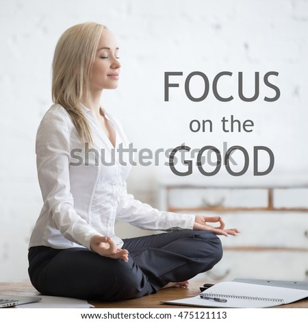 office meditation. business and healthy lifestyle concept portrait of young office woman sitting crosslegged in meditation