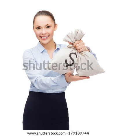 business and money concept - young businesswoman holding money bags with dollar - stock photo
