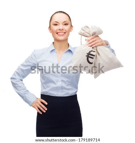 business and money concept - young businesswoman holding money bags with euro - stock photo