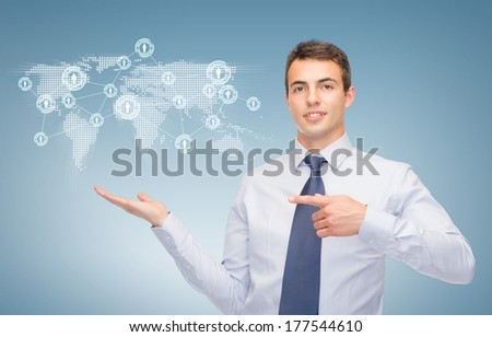 business and office, advertising, people concept - friendly young buisnessman showing map and network on the palm of his hand - stock photo