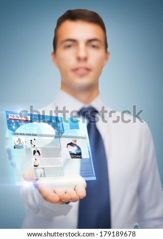 business and office, advertising, people concept - friendly young buisnessman showing something on the palm of his hand - stock photo