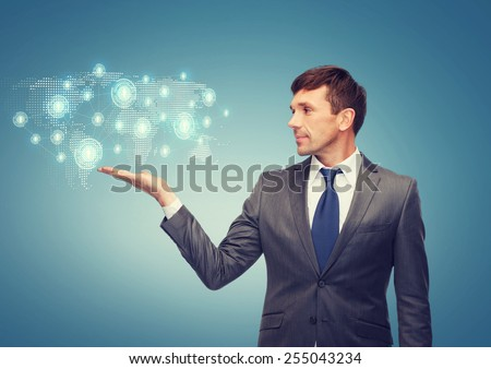 business and office concept - attractive buisnessman or teacher showing world map hologram on the palm - stock photo
