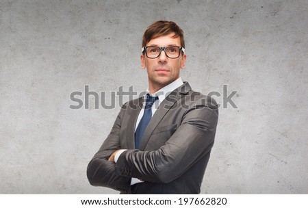 business and office concept - attractive businessman or teacher in glasses - stock photo