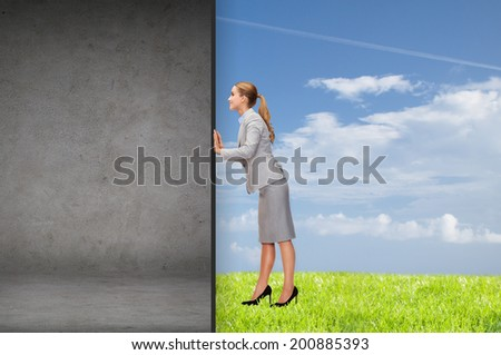 business and office concept - businesswoman pushing away concrete wall