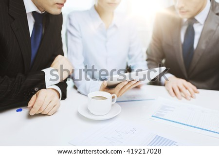 business and office concept - close up of business team with chart, graph, tablet pc and coffee - stock photo