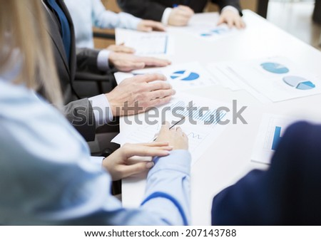 business and office concept - close up of business team with chats and graphs in office - stock photo