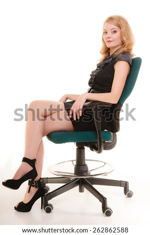 business and office concept - elegant businesswoman in full length sitting on a chair - stock photo