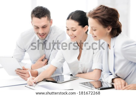 business and office concept - friendly business team with tablet pcs having discussion in office