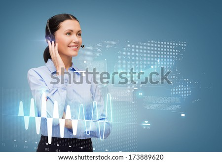 business and office concept - friendly female helpline operator with headphones - stock photo