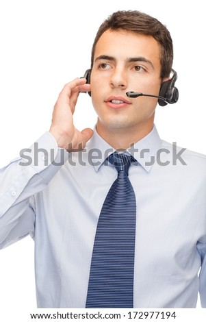 business and office concept - friendly male helpline operator with headphones - stock photo