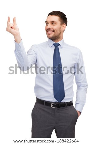 business and office concept - handsome buisnessman holding imaginary light bulb - stock photo