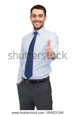 business and office concept - handsome buisnessman showing thumbs up - stock photo
