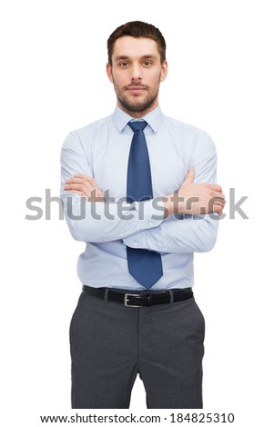 business and office concept - handsome buisnessman with crossed arms - stock photo