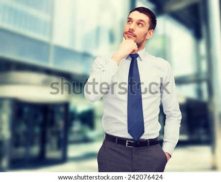 business and office concept - handsome businessman looking up - stock photo
