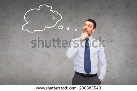 business and office concept - handsome businessman looking up at text bubble