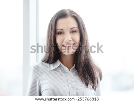 business and office concept - happy businesswoman in office - stock photo