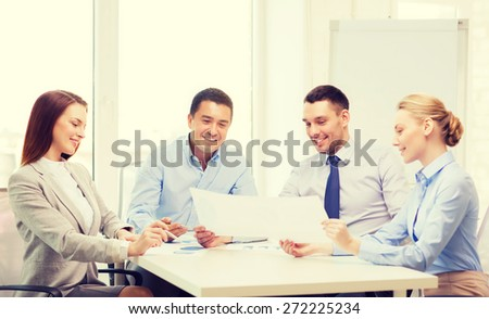 business and office concept - smiling business team having discussion in office - stock photo