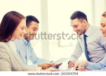 business and office concept - smiling business team having meeting in office - stock photo