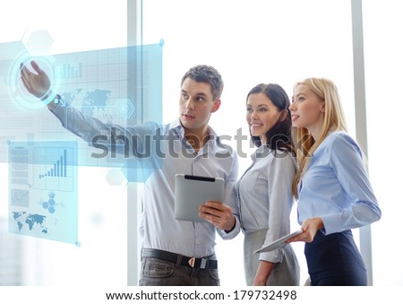 business and office concept - smiling business team working with tablet pcs in office - stock photo