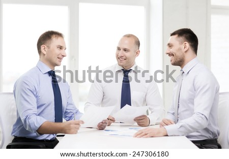 business and office concept - smiling businessmen with papers in office - stock photo