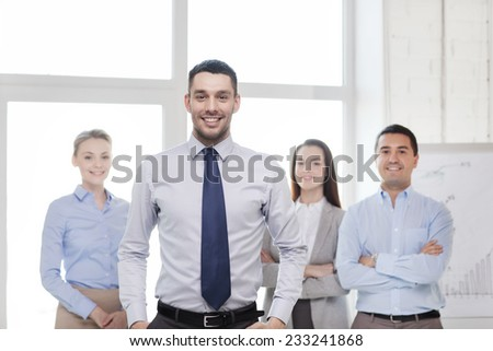 business and office concept - smiling handsome businessman with team in office - stock photo